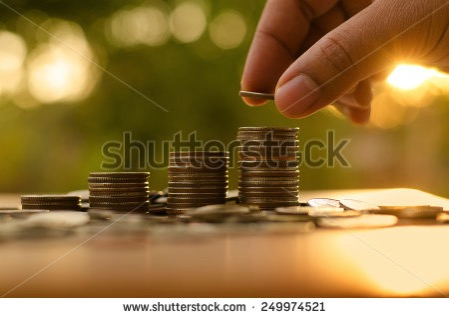Stock photo saving money concept male hand putting money coin stack growing business 249974521 1